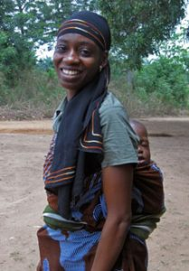 A Nigerian women carrying her child on her back